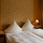 an image of a double bed in our rooms